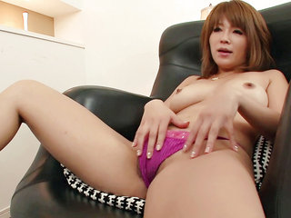 Rika Aina in fishnet nylons plays with her furry snatch